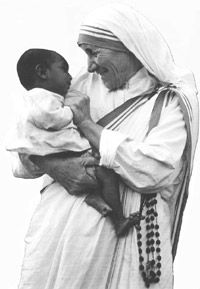 Mother Theresa smiling w/a young child