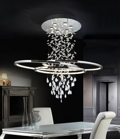 #lamp made of metal, chrome finish. White crystal drops with clear edge. Ovals with LED #lighting and white methacrylate diffuser. LED stripe of 82W. 3000K. This item includes 6 GU10 LED 7W