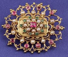 Victorian Anglo-Indian 15kt Gold Gem-set Brooch, set with rubies, emerald and seed pearls, 1 1/2 x 1 1/4 in.