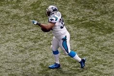 NEW ORLEANS, LA - DECEMBER 30: Mike Tolbert #35 of the Carolina Panthers celebrates after scoring a touchdown against the New Orleans Saints at the Mercedes-Benz Superdome on December 30, 2012 in New Orleans, Louisiana. (Photo by Chris Graythen/Getty Images)