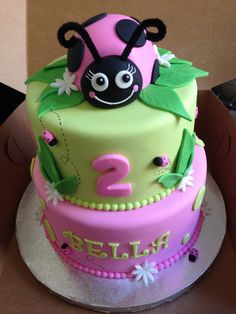 "Ladybug Cake - 9"" & 6"" cakes covered with HMMF. Ladybug is made of cereal treats covered with fondant."