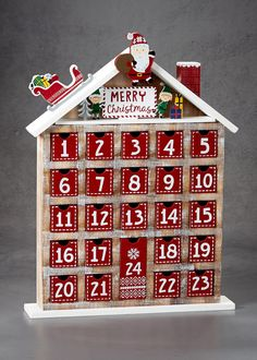 Wooden Christmas advent calendar with individual numbered drawers for you to put treats in each day. Dimensions: 44cm x 33cm.