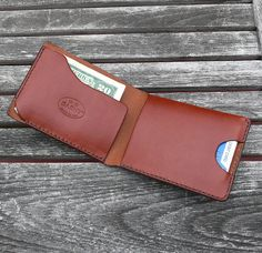 GARNY № 2 Available colors: CHESTNUT BROWN, BLACK, WHISKEY & DARK BROWN Handcrafted from one piece chestnut brown, vegetable dyed cow hide. The edge is coated and polished. Perfect fit for any pocket, front or back, tight or loose without bulk. It will hold credit cards, drivers