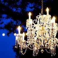 chandelier at night with a bright blue sky