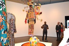 "Artist Nick Cave talks about the inspiration behind this sculptural piece, and how it transports him to the circus.     ""I wanted something standing on top of the elephant,"" said Cave. ""And then I thought, I want a rug underneath it. And this gives it a sort of sunburst effect."""