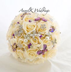 Beautiful silk rose bouquet with clear and purple crystal butterfly brooches by AngelK Weddings.