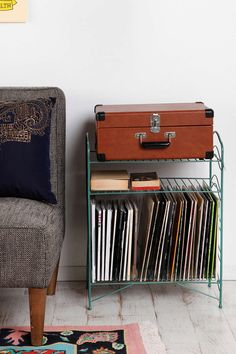 I may have to succumb to the lure of Urban Outfitters and buy the Turquoise Vinyl Record Storage Shelf :/