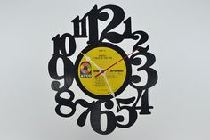 Vinyl Record Album Wall Clock artist is Genesis by vinylclockwork, $23.00
