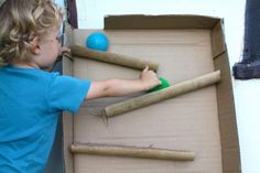Ball Maze - large cardboard box and cardboard tubes make a maze. Large Cardboard Boxes, Cardboard Play, Cardboard Tubes, Sensory Activities, Toddler Activities, Autism Sensory, Classroom Activities, Projects For Kids, Crafts For Kids