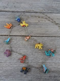 Folk Art Carved & Painted Animal Charm Necklace by bettyrayvintage