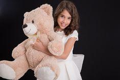 Fotos niña con traje de comunion en estudio