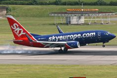 A now defunct airline which used to be a regular at Manchester OM-NGQ - SkyEurope - B737