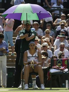 PHOTOS: Wimbledon Women's Final. Marion Bartoli of France shelters from the sun as she plays Sabine Lisicki of Germany during their Women's singles final match at the All England Lawn Tennis Championships in Wimbledon, London, Saturday, July 6, 2013. (AP Photo/Anja Niedringhaus)