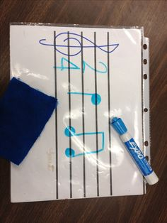 Staff paper with a treble clef drawn on, put into a sheet protector. The kids can trace the treble clef and use to practice drawing notes & etc