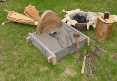 forge body is made up of a mortise and tenon box with high temperature refractory cement cast to be the forge table and pan.