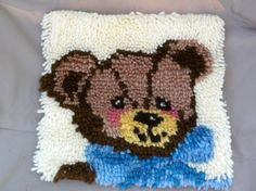 READY TO SHIP   12 1/2 x 11 1/2 31.75 cm x 29.21 cm  This rug has a off white background with a brown teddy bear with blue clothes. The pattern is made with individual pieces of acrylic yarn! A great addition to any childrens room! Also, great for a baby boys nursery!  Here is another hook latch rug! https://www.etsy.com/listing/166308631/carousel-horse-rug?ref=shop_home_active_2&ga_search_query=hook%2Blatch%2Brug  I hope as you are looking at my shop, my items reflect what Psalm 127:3 says…