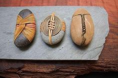 Stones wrapped in weaving – Del Webber.