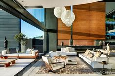 contemporist - modern architecture - saota - nettleton 199 house - cape town - south africa - interior view & exterior view - living room & deck