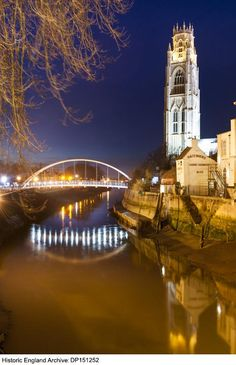 inch) Print (other products available) - St Botolph& Bridge, Boston, Lincolnshire. The new footbridge over the river Haven from the south, illuminated at dusk, with St Botolph& church beyond. - Image supplied by Historic England - Print made in Australia Fine Art Prints, Framed Prints, Over The River, England And Scotland, Photographic Prints, Poster Size Prints, Dusk, Photo Mugs, Saints