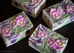 """""""I used a small cookie cutter to make these tiny flower using melt and pour soap base ahead of time then """"glued"""" some sugar pearls with cold process soap in the center of each blossom."""""""