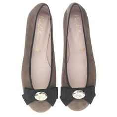 beige shoes with black bow