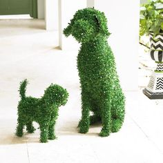You don't need a country estate or master gardener to enjoy the    everlasting charm of our Moxie Faux Boxwood Garden Dog. She doesn't    require grooming or water, and never barks! A simple and playful way to    fetch smile after smile in the garden, at an entryway, or nearly anywhere    in your landscape. Lifelike all-weather materials mimic lush, healthy,    natural boxwood, down to the smallest details, and maintain their beauty    season after season. Moxie's easy to live...