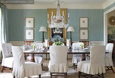 blue dining room; love the pictures flanking the buffet