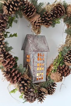 Winter pinecone heart-shaped wreath with flecks of greenery and a vintage metal house - awesome!