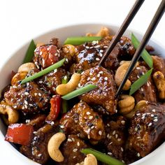 20 Minute Cashew Chicken Recipe Main Dishes with chicken breasts, corn starch, oil, low sodium soy sauce, rice vinegar, light brown sugar, sesame oil, hoisin sauce, raw cashews, sesame seeds, sesame seeds
