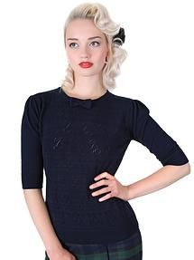 Collectif Annie Cherry  Top Blue The Annie Cherry Top is an adorable pin-up inspired knitted separate. This style features openwork cherry patterns, puff half sleeves and a kitsch knitted bow on the neckline. Team with the Cigarette Trousers for a casual retro look or Circle Skirts for a cutesy pin-up style. http://www.audreystarsboutique.com/#!product/prd1/1626351995/collectif-annie-cherry-knitted-vintage-top-blue