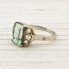 Vintage White and Yellow Gold Emerald Engagement Ring