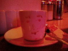 face on tea cup  (realized from hisbiscus tea)