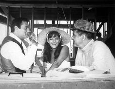 Tony Curtis tells an amusing story to Don't Make Waves costars Claudia Cardinale and Jim Backus 1967