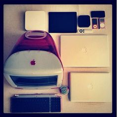 red candyshell iMac and iPod Mini playing nicely with Apple's newest products
