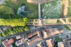 An aerial picture shows a painting made by Saype for the Eurockéennes festival in Belfort, France, in July. Land Art, Origami Boat, Message Of Hope, French Artists, Landscape Art, Picture Show, Top Artists, Street Art, France