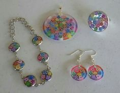 Resin jewellery. I made these 'Mille Fleur' pieces (as I call them as they remind me of the Italian glass Millefiore style jewellery) with slices of polymer clay flower canes.