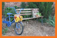 We learned to decorate with what we had, and to live on very little.  (The bike was found in the trash, the basket was 50 cents at goodwill store, and the Butterfly House was a gift, the Bench was a refirnished rusty thing found along the road in the garbage.