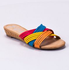 Criss Cross Sandal with a slight wedge heel. These would work well with any number of outfits.