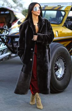 Kim Kardashian in a long fur coat and boots - click ahead for more winter outfit ideas!