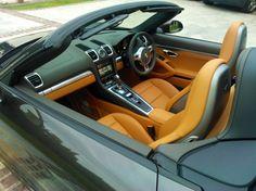porsche cayman amber orange silver black grey interior. brown camel