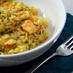 Seafood Risotto - risotto infused with saffron, and finished with scallops, shrimp, tomatoes, and basil.