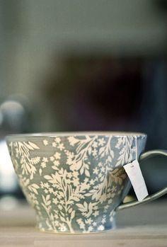 grey teacup - white flowers
