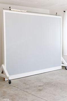 No picture perfect home . . . no problem.  Catch the DIY tutorial and photo results for this dual sided Wall on Wheels photography and filming backdrop, which is key to our garage studio. #photography #studio #filming #backdrop #wallonwheels #studiobackdrop #photographybackdrop #camitidbits #tutorial #wall