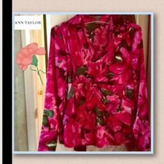 🎉HOST PICK 8/13/14🎉Ann Taylor floral silk blouse This is a beautiful and unique floral print blouse it is a silky texture however it isn't made of real silk. I'm selling this for my mom because she doesn't wear it. It's in perfect condition only worn a few times. It has a zipper on the side making it easier to put on. *price firm unless bundled*                                                                          💕SALE!!! BUY ONE GET ONE 50% OFF EVERYTHING IN MY CLOSET!!! 💕 Ann…