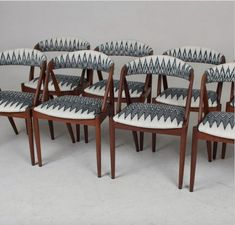 Minimalist black and white Catarine ikat from A Rum Fellow is a perfect contrast on these teak mid century chairs