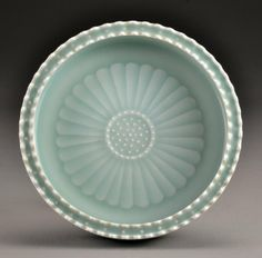 """Chinese Light Celedon Molded Porcelain Brushwash Finely molded as a lotus blossom, the interior depicting petals and seeds, base having seal mark in underglaze blue, 2.25""""H X 7.5""""D."""