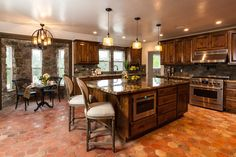 traditional-kitchen-with-terra-cotta-tile-floors-stone-walls