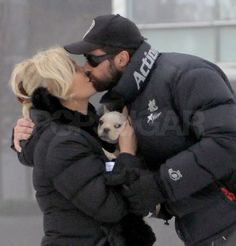 Hugh Jackman steals a kiss from wife Deborah.