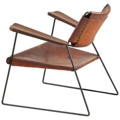 Rare Studio Furniture Chair with Heavy Saddle Leather   From a unique collection of antique and modern lounge chairs at https://www.1stdibs.com/furniture/seating/lounge-chairs/