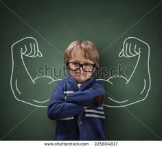 Strong man child showing bicep muscles concept for strength, confidence or defense from bullying - stock photo